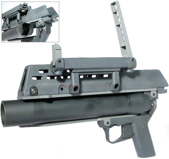 AG36 казенная часть ствола откинута вбок для перезарядки