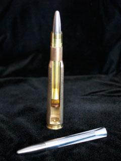 Корректируемая пуля и патрон в разрезе