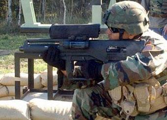 американский военнослужащий с XM25