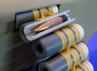 Телескопический патрон LSAT состоит из пули, капсюля, порохового заряда и пластиковой гильзы
