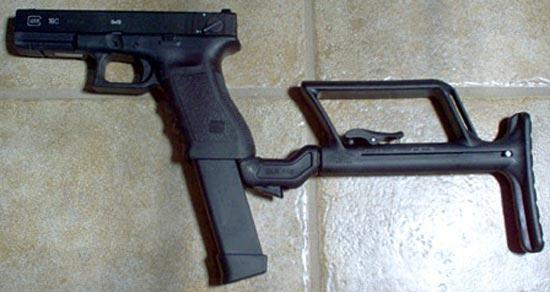 Glock 18C с установленным складным прикладом и магазином емкостью на 33 патрона