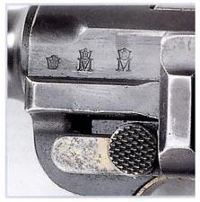 Расположение приемочных клейм с годом выпуска на пистолете модели 04-06.