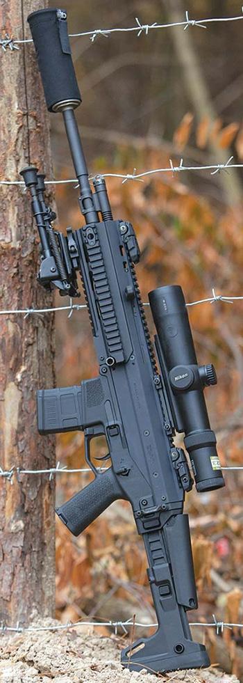 После установки на Bushmaster ACR 10-кратного оптического прицела Nikon,  сошек Harris и саунд-модератора Ase Utra SL7 она превращается в своего  рода DMR-вариант