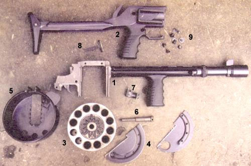 Неполная разборка ружья «Протекта»: 1 - спусковая рама со стволом, дульным тормозом-компенсатором, защитным кожухом, передней рукояткой удержания и экстрактором, 2 - приклад с задней рукояткой удержания, 3 - блок патронников, 4 - разрезная крышка барабана, 5 - корпус барабана, 6 - ось барабана, 7 - поволок механизма перезаряжания, 8 - задняя антабка, 9 - крепёжные винты с шайбами