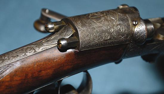 Изящная гравировка, изысканный орех— это признаки неординарного ружья.  Нонетолько вэтом привлекательность оружия: оригинальность  конструкции делает его памятником общемировой истории оружейных систем.