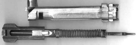 На фото - затворная группа ТОЗ-106. Цифрами обозначены: 1 - упорно-взводной зуб боевой пружины, при повороте рукоятки он отжимается на