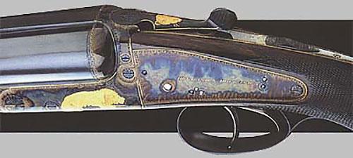 Двуствольный штуцер-нитроэкспресс «модель Dominion» (№ 31059) калибра .375 с обратными замками на досках. Сюжетная инкрустация золотом на африканскую тему. Ружьё сделано в 1935 году.