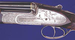 Бонфлинт на основе системы «Босс», украшенное изображением уток, выполненных в технике булино и традиционной рельефной гравировкой