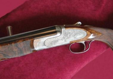 Сюжет с утками украшает боковые пластины на колодке ружья Perugini & Visini