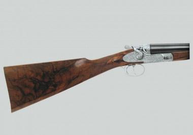 Современное курковое ружье Beretta Diana высокого класса декорировано в фирменном стиле гравировкой с углубленным фоном