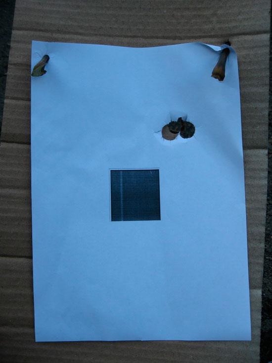 три попадания в мишень пули Иванова из Вепря-12, с дистанции 35 м. Марка прицела специально смещена в сторону