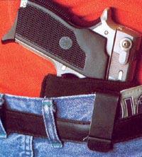 Скрытое ношение пистолета Smith & Wesson M 469 в «оперативной» кобуре за поясом