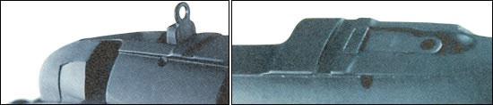 Дополнительный прицел диоптрического типа работает совместно с мушкой, помещенной на переднюю часть ствольной коробки. Оба устройства имеют регулировку для пристрелки оружия и оба складываются, когда их не используют